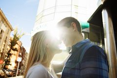 Sunbeam, the sun between the lips and the faces of a loving couple date.the sun shines on the faces, the rays of the sun between a. Sunbeam, rays from the sun royalty free stock photos
