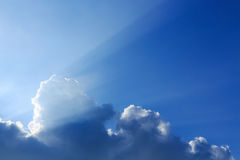 Sunbeam of sunlight through clouds Stock Photo