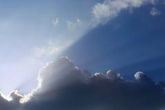 Sunbeam of sunlight through clouds Stock Photos