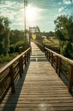 Sunbeam and wooden bridge over the Adaja River at Avila stock image
