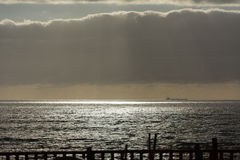 Sunbeaming through Clouds onto Ocean Royalty Free Stock Image