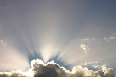 Sunbeams. Behind a cloud stock photography