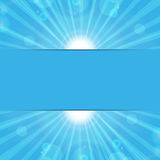 Sunbeams on a blue background Stock Image