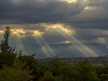 Sunbeams casting their light over the valley II royalty free stock photos