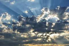 Sunbeams Through the Clouds. With a Blue Sky stock images