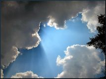 Sunbeams through clouds Stock Photography
