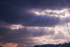 Sunbeams through clouds Royalty Free Stock Images