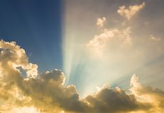 Sunbeams through the clouds stock image