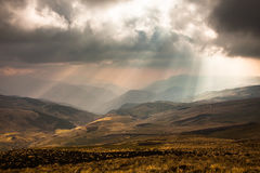 Sunbeams through the clouds. At sunset in the Ecuadorian Andes Stock Images