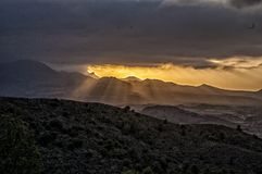 Sunbeams descending through the clouds. Landscape with sunbeams descending through the clouds Stock Photography