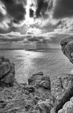 Looking out at sunbeams shining down on the sea. Land`s End, Cornwall. Stock Photos