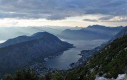 Sunbeams illuminating the city and the bay of Kotor royalty free stock photos