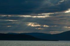 Sunbeams im Himmel Stockfotos