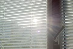 Sunbeams making their way through the blinds Royalty Free Stock Photography