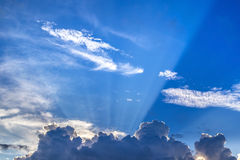 Sunbeams over on blue sky Royalty Free Stock Photography