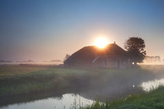 Sunbeams over farmhouse Stock Images