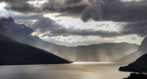 Sunbeams over lake Stock Photo