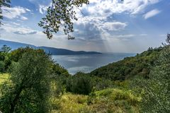 Sunbeams over lake garda royalty free stock image