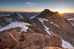 Sunbeams over rocky mountains. Sunset. Royalty Free Stock Photography