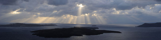 Sunbeams over Santorini volcano. Panorama. Royalty Free Stock Photography