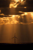 Sunbeams over a windfarm Royalty Free Stock Image