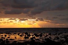 Sunbeams over a windfarm Royalty Free Stock Photo