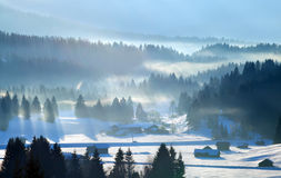 Sunbeams over winter Alps Royalty Free Stock Photo