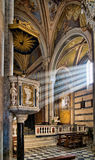 Sunbeams on pulpit, village church interior - Corniglia Royalty Free Stock Image