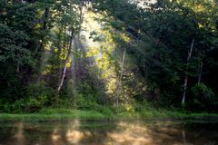 Sunbeams on a River Royalty Free Stock Photo