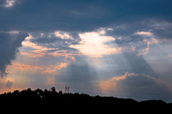 Sunbeams and rosy clouds Stock Images