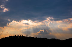 Sunbeams through rosy clouds Stock Images