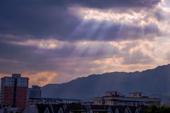 Sunbeams through rosy clouds Royalty Free Stock Images