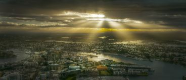 Sunbeams shining over city Royalty Free Stock Photos