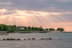 Sunbeams or sun rays at a sunrise on a beach in Sunny Beach on the Black Sea coast of Bulgaria. Crepuscular bulgarian clouds coastline dawn day god morning no stock photography