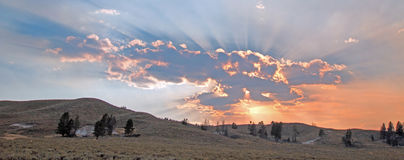 Sunbeams and sunrays through sunset clouds in the Hayden Valley in Yellowstone National Park in Wyoming Royalty Free Stock Images