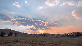 Sunbeams and sunrays through sunset clouds in the Hayden Valley in Yellowstone National Park in Wyoming Stock Photography