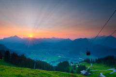 Sunbeams while sunrise in austrian mountains Royalty Free Stock Images