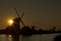 Sunbeams and windmills Stock Photography