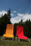 Sunbed. Red and yellow sunbed on grass outdoor Stock Photos