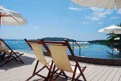 Sunbed on the adriatic beach. Empty sunbeds near the pool on the adriatic beach stock image