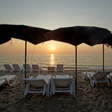 Sunbed on the beach. With beautiful sunrise background Royalty Free Stock Photo