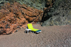 Sunbed on the beach. In front of rock Royalty Free Stock Photos