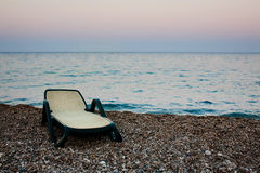 Sunbed on beach of the sea. In evening Royalty Free Stock Photos