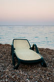 Sunbed on beach of the sea. In evening Royalty Free Stock Photography