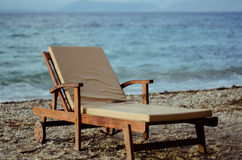 Sunbed on beach. A single sunbed on a pebble beach in Greece, the Mediterranean sea behind Royalty Free Stock Photos
