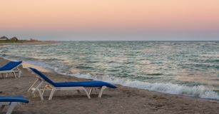 Sunbed on the beach during sunset. Sunbed on the beach during sunset Royalty Free Stock Photos