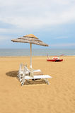Sunbed. Beach with umbrellas and sunbeds in rimini,italy in summer Stock Photos