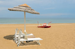 Sunbed. Beach with umbrellas and sunbeds in rimini,italy in summer Royalty Free Stock Photo
