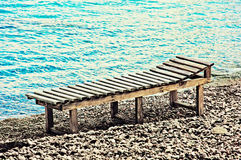 Sunbed on the beach. Wooden sunbed on the beach Royalty Free Stock Photo