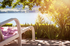 Sunbed at a beautiful terrace with lake view Stock Photos